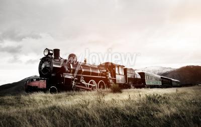 Fototapet Steam Train i en öppen landsbygd Transport Concept